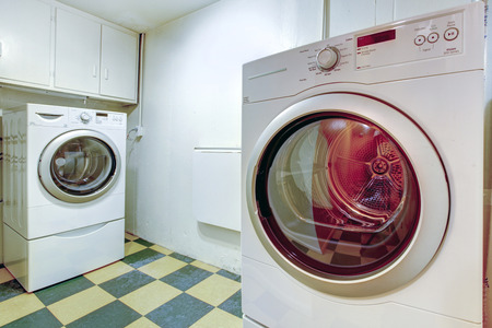 View of washer and dryer mashines. Practical laundry room