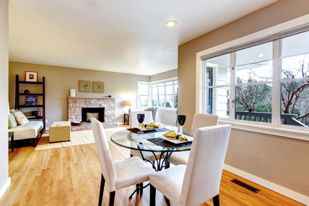 room: Open design for living and dining room interior. View of the served dining table and living room Stock Photo