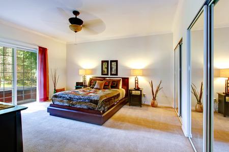 closet door: Beautiful tropical theme bedroom with a carpet floor, mirror door closet and walkout deck