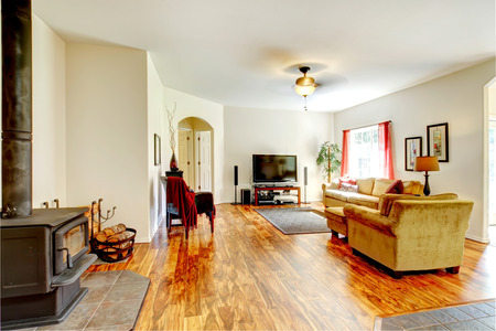 Beautiful hardwood floor living room with an antique stove. Stock Photo - 26451152