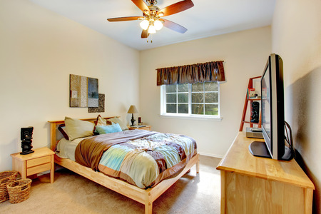 Warm bedroom with marple bed and chest. Decorated with wicker baskets and wall pictures. photo