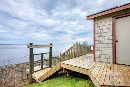 private access: Waterfront beach boat house storage shed with winter Port Ludlow Beach.