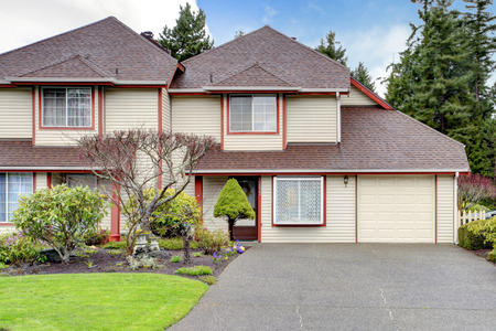 appeal: Two story siding house with garage. View of curb appeal and drive way Stock Photo