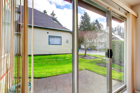 slide glass: Slide glass door. View of the outside from the dining area Stock Photo