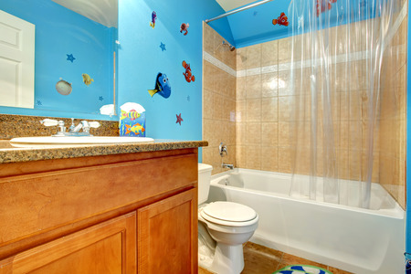 Beige bathroom with designed blue wall. photo