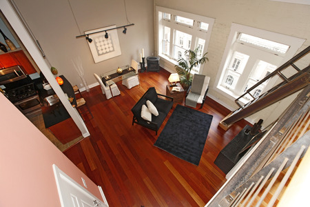 Panoramic view of modern reconstructed living room from a mezzanine corner photo
