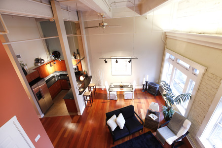 Panoramic view of modern reconstructed living and kitchen room from a mezzanine photo