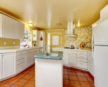 trim wall: Ivory wall kitchen room wtih white storage combination and stone trim wall Stock Photo