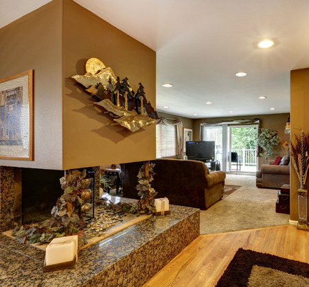 metal base: House interior  View of decorated with a metal art fireplace on a marble base Stock Photo