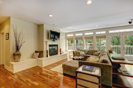 family rooms: Spacious living room with walkout deck  View of couch with coffee table, fireplace and TV Stock Photo