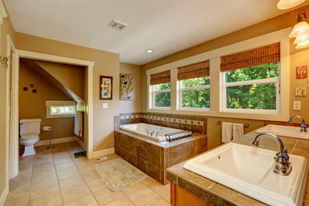 Bathroom With Ceramic Floor, Tile Base Tub, Washbasin Cabinet ...
