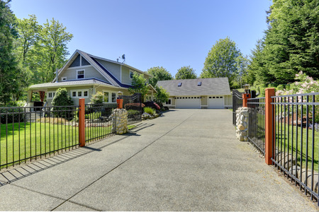 View of open entrance iron gates and driveway  photo