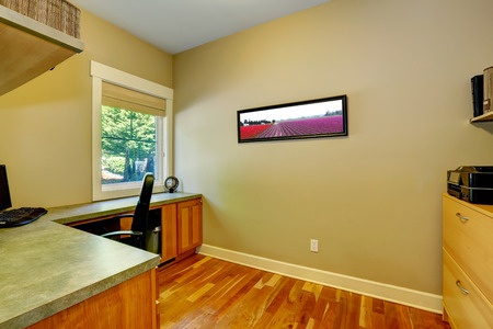 Office with corner desk  View of window, desk and wall picture Stock Photo - 26867347