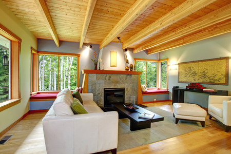 Blend of log cabin interior with elegant black and white furniture  photo
