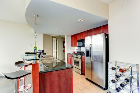 Bright burgundy kitchen room with bar and wine rack photo