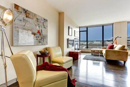 furnished: Living room with glass wall  Furnished with yellow chairs Stock Photo