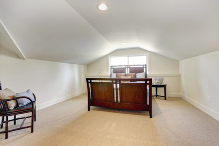 ceiling: Bedroom with low vaulted ceiling. View of beautiful bedroom furniture set Stock Photo