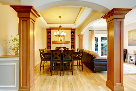 classic living room: Luxury dining room with column arch. View of classic dining table set