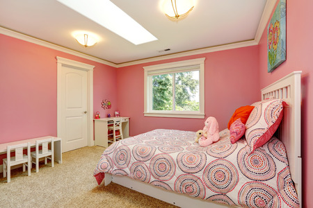 Cozy and gentle colors bedroom for girls. Pink walls blend with bedding.