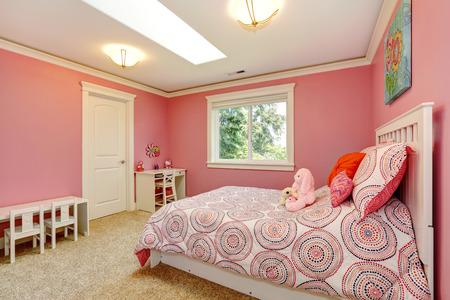 Cozy and gentle colors bedroom for girls. Pink walls blend with bedding. Reklamní fotografie - 27261982
