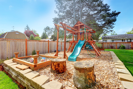 fenced: Fenced backyar with big playground for kids. Stock Photo