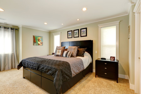 nightstand: Beautiful bedroom with  elegant black queen size bed and nightstand
