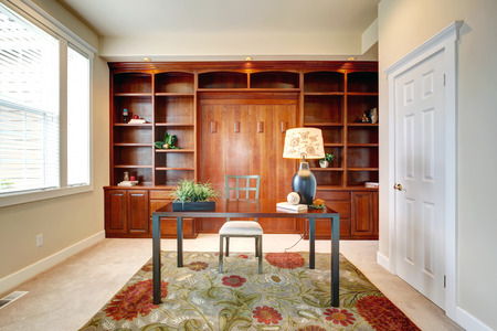 furniture: Bright office room with storage combination and desk.