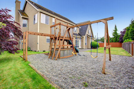 Playground with swings, ladder. Backyard view photo