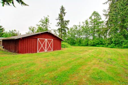 sheds: Red wooden barn on picturesque farn land
