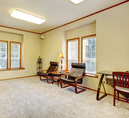 trim wall: Cozy room with brick fireplace, leacher chairs and desk