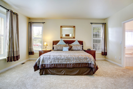 master bedroom: Elegant master bedroom with rich furniture set and beautiful bedding