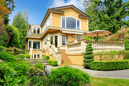 Luxury house with walkout deck. Backyard view.