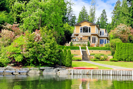 Amazing luxury house with beautiful landscape and private dock. View from the boat Stock Photo