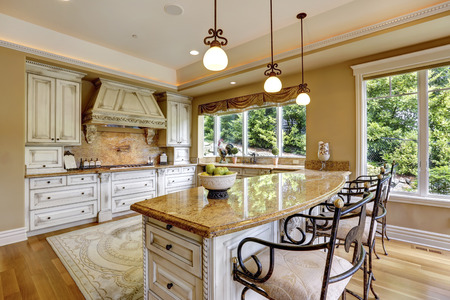 kitchen cabinets: Luxury kitchen room with island and chairs. Stock Photo