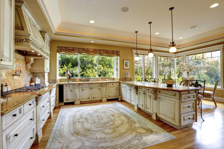 Spacious kitchen room with antique storage combination photo