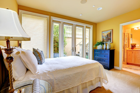 Beautiful bedroom with walkout deck and bathroom photo
