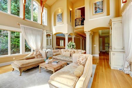 impressive: Impressive high ceiling living room antique furniture and columns