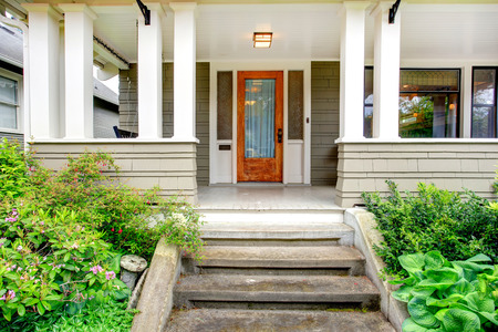 front view: House exterior  View of entrance column porch with stairs  Stock Photo
