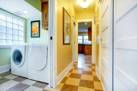 MInt laundry room with glass block window  View of yellow tones small hallway photo