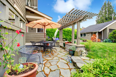 porch: Backyard patio area with umbrella and pergola