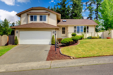 garage on house: Clapboard siding house with tile roof  House has deck and garage