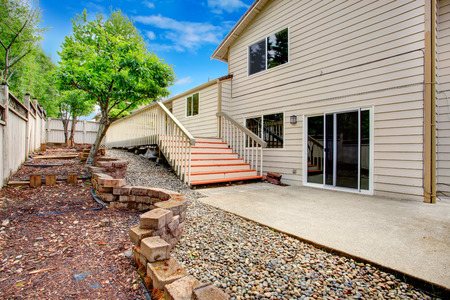 land slide: Big house with back walkout deck  View of landscape with growing trees on designed with bricks land