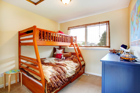 small room: Small cozy kids room with two level bed and blue cabinet Stock Photo