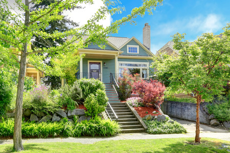 curb appeal: Clapboard siding house   View of entrance column porch with railings and stairs  House has beautiful green landscape