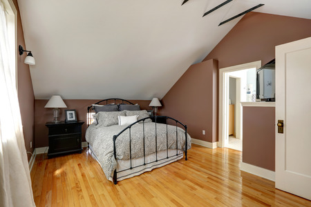 nightstands: White and mocha velux bedroom with iron frame bed and black nightstands Stock Photo