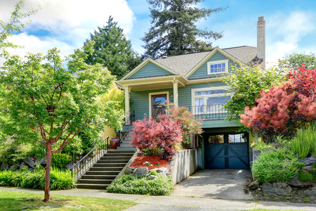 garage on house: Clapboard siding house with entrance column porch  View of garage and driveway Stock Photo