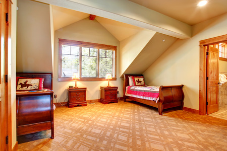 nightstands: Vaulted ceiling bedroom with two single beds and nightstands