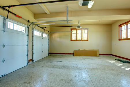 residential home: Empty garage with roller door  View of horizontal tracks  Stock Photo