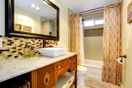 vessel sink: Bathroom interior. Antique cabinet with marble counter top and white vessel sink Stock Photo