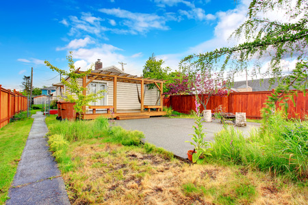 fenced: Fenced backyard with pergola and rest area Stock Photo